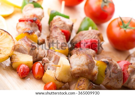 Close up Mouth Watering Gourmet Barbecue on Wooden Chopping Board at the Table