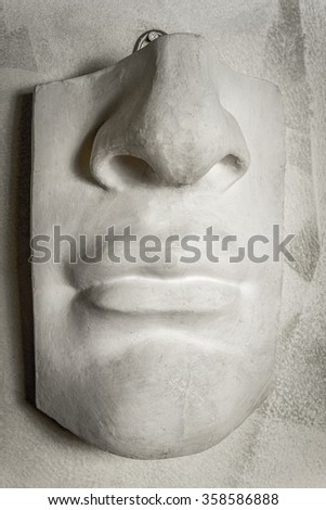 Close up mouth with a nose in sculpture.