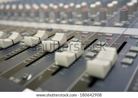 Close up multi color buttons of sound mixer console, shallow depth of field (DOF) - stock photo
