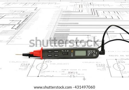 Close up multimeter pen type on  paper schematics. - stock photo