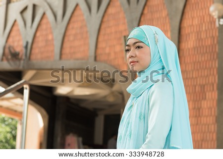 Close up muslim woman stand front of masque
