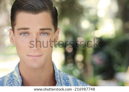 Close up natural portrait of a confident handsome young man - stock photo