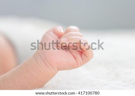 Close up newborn baby hand on sleeping - stock photo
