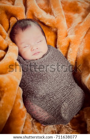 Close-up newborn baby sleeping on a blanket. soft focus.