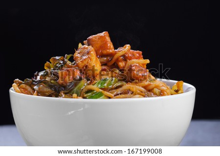 Close Up Noodles with Szechuan Tomato Sauce, Chicken and Vegetables  - stock photo