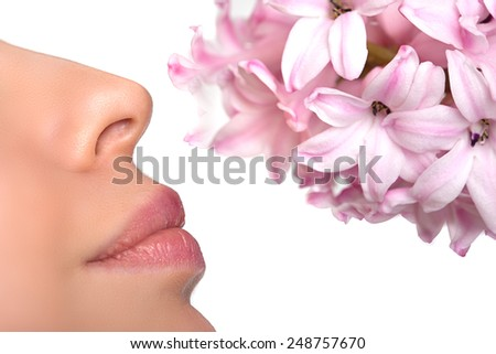 Close-up nose and a flower. Allergy to pollen of flowers. asthma attack.  Floral fragrance, perfumes - stock photo