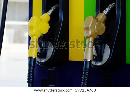 Close up nozzle fuel in gas station