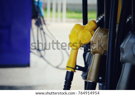 close up nozzle fuel in gas station, transport and business concept, process vintage tone