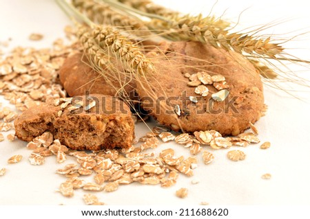 Close up oats and biscuit on a white background - stock photo