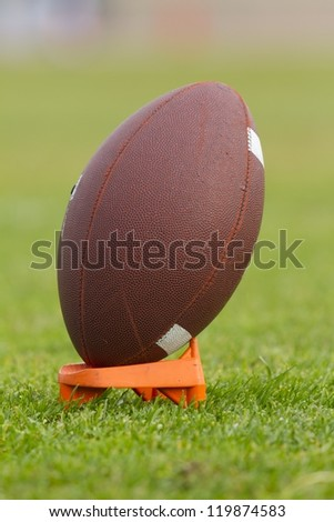 Close up of a American football on its support