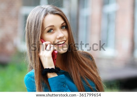 Close Up Of A Attractive Young Woman Speaking On Mobile Phone - stock photo