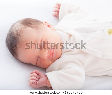 Close-up of a baby boy sleeping - stock photo