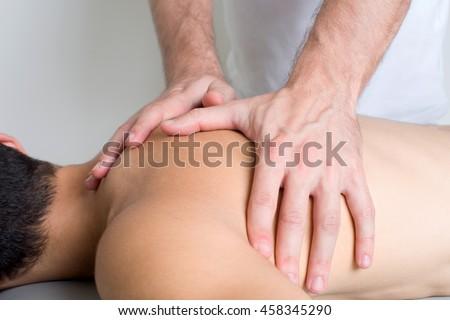 close up of a back massage - stock photo