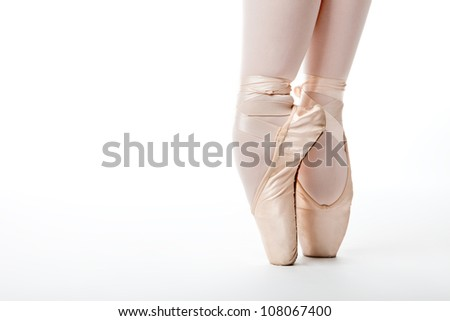 close up of a ballerina's legs and shoes