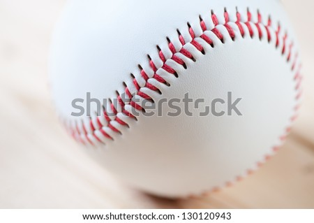 Close-up of a baseball ball on wooden boards, studio shot