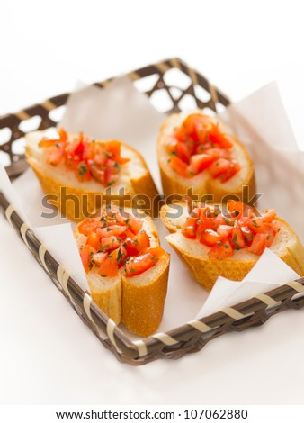 close up of a basket of bruschetta bread - stock photo