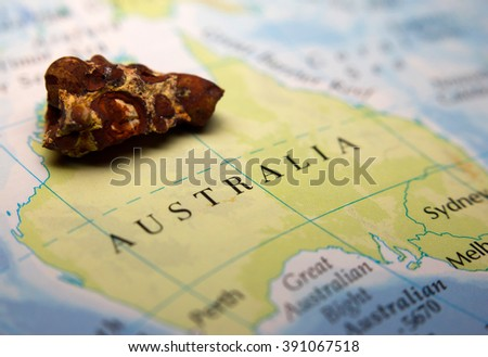 Close-up of a Bauxite mineral on top of a map of Australia - stock photo