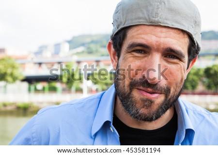 Close-up of a bearded man and Irish cap on backwards - stock photo