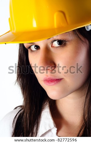 Close up of a beautiful architect woman against isolated white background
