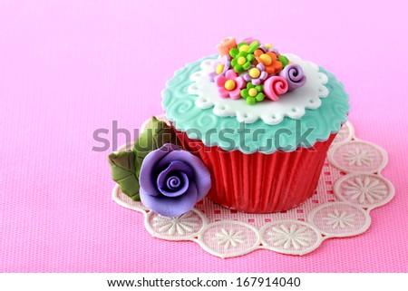 close up of a beautiful colorful cupcake - stock photo