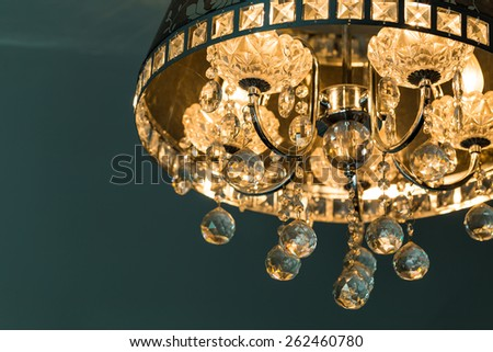 Close-up of a beautiful crystal chandelier with reflection