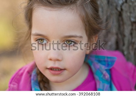close up of a beautiful girl with green eyes, outdoor portrait - stock photo