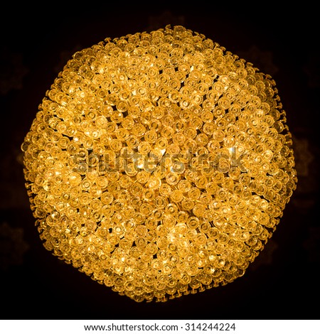 close up of a beautiful golden crystal chandelier - stock photo