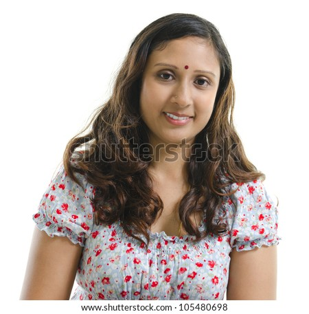 Close-up of a beautiful Indian woman smiling on white background