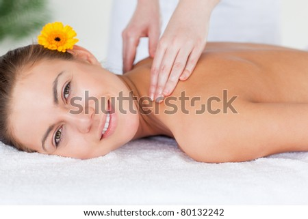 Close up of a beautiful woman having a shoulder massage in a spa