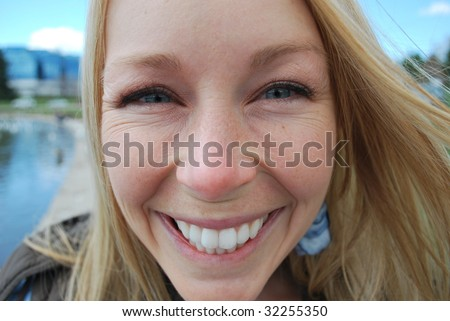 Close up of a beautiful woman with lots of smile lines - stock photo