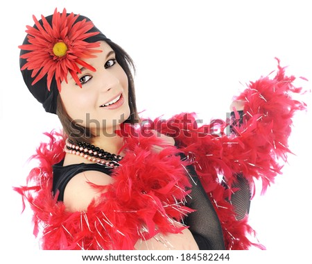 Close-up of a beautiful young flapper dressed in black and red, and wrapped in a feathery boa.   On a white background.