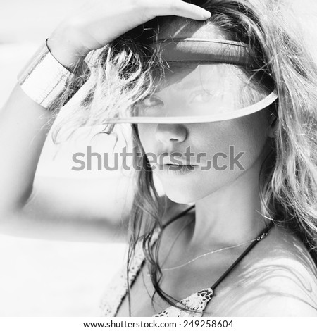 Close-up of a beautiful young  girl on the beach. Black white female face. outdoors lifestyle - stock photo