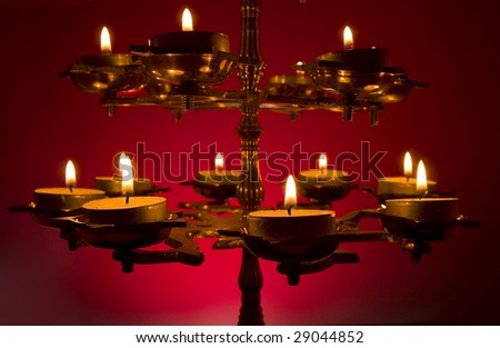 Close-up of a Beautifully Lit Lamp on a Deep Red Background - stock photo