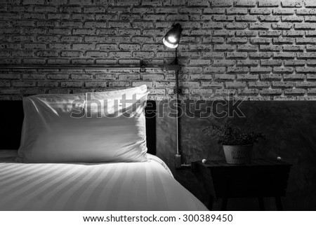Close up of a bed with lamp light - stock photo