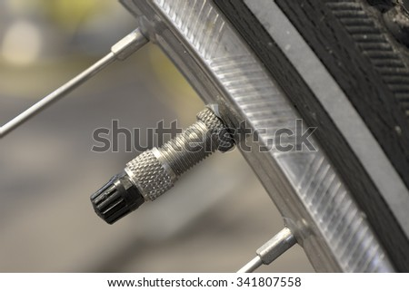 Close up of a bike valve of a tire - stock photo