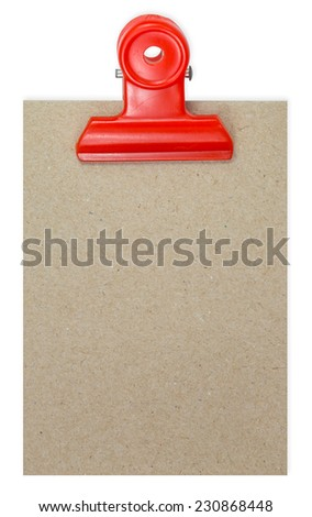 Close up of a binder clip attached to sheet of paper - stock photo