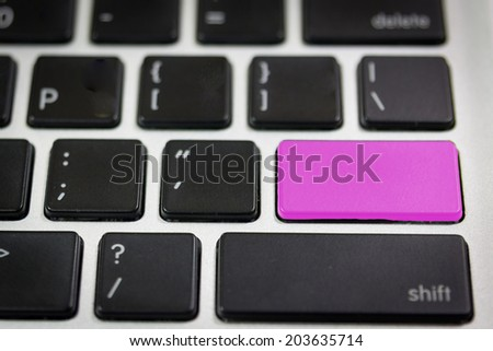 Close up of a black keyboard with a button in pink - stock photo