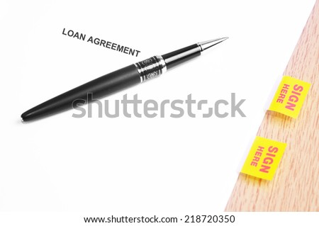 Close Up Of A Black Pen And Loan Agreement With Sign Here Stickers  - stock photo