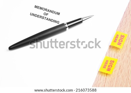 Close Up Of A Black Pen And Memorandum Of Understanding Agreement With Sign Here Stickers  - stock photo