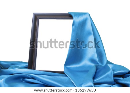 close up of a black wooden frame covered with blue silk on white background with clipping path - stock photo
