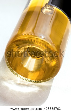 Close up of a bottle of Bordeaux white wine on a table