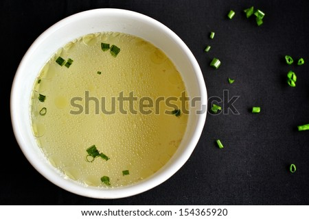 close up of a bowl chicken soup stock - stock photo