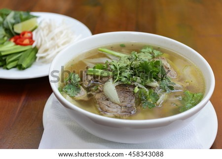Close up of a bowl  Chinese style on wooden background ,Beef Noodle Soup - stock photo