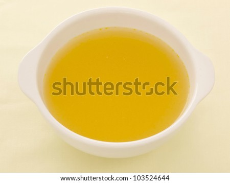 close up of a bowl of chicken broth - stock photo