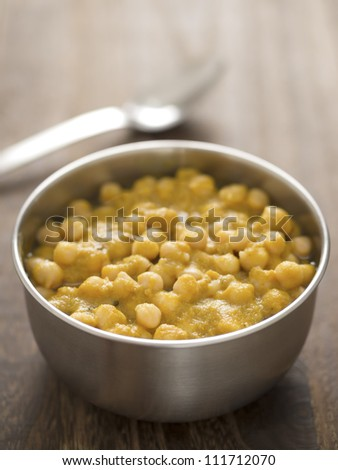 close up of a bowl of chickpea curry - stock photo