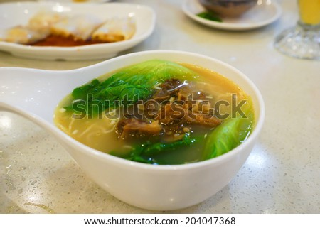 Close up of a bowl of Chinese style beef noodle soup.  - stock photo