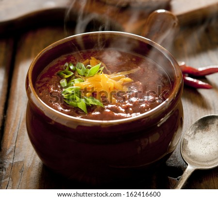 Close up of a bowl of steaming hot chili con carne. - stock photo