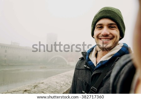 Close-up of a boy taking a selfie of himself, on Holiday - lifestyle, people, outdoor and Holiday concept - stock photo