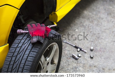 Close up of a breakdown car in the process of repairing. With copy space on the right. - stock photo
