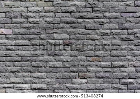 Close up of a brick-wall, Modern stone Black texture background ,Stone wall background , grungy style
